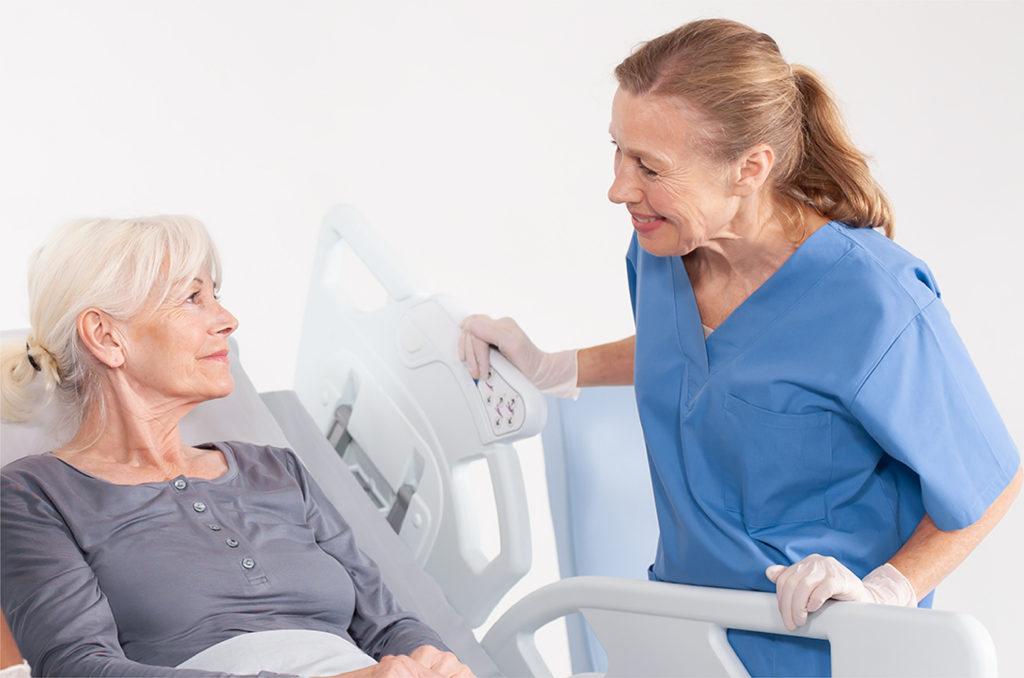 Nurse talking to patient in hospital